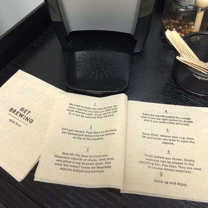 "Front and middle panels of ""instructional booklet"" custom napkin, depicting how to use Keurig coffee maker"